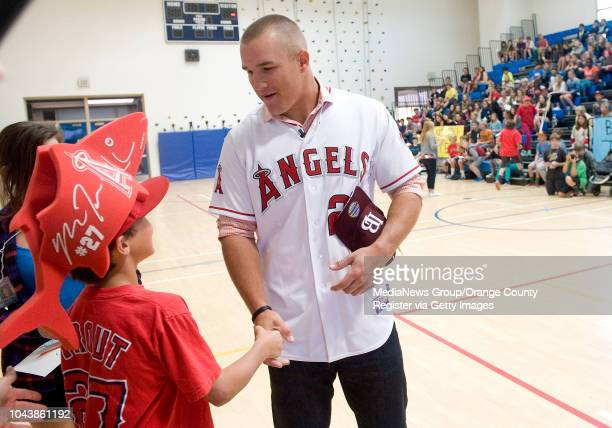 Angels outfielder Mike Trout greets a fan during an assembly at Thurston Middle School in Laguna Beach CA on April 11 2013 Trout visited three schools
