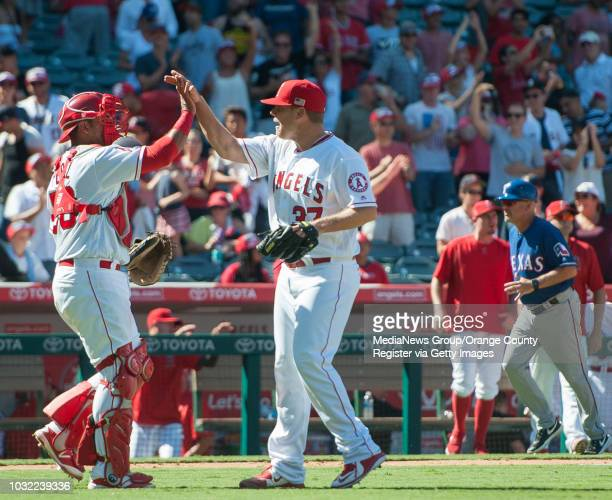 Angels' relief pitcher Andrew Bailey celebrates with catcher Carlos Perez after the Angels' 32 victory over the Texas Rangers on Sunday Sept 11 2016...