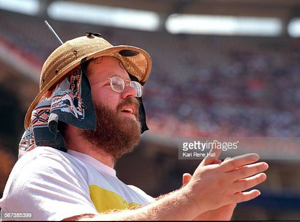LSAngelsradio3KH8/7/95Ben Thompson of Lakewood stands and cheers on the Angels while listening to the game on a radio built in to a straw pith helmet...