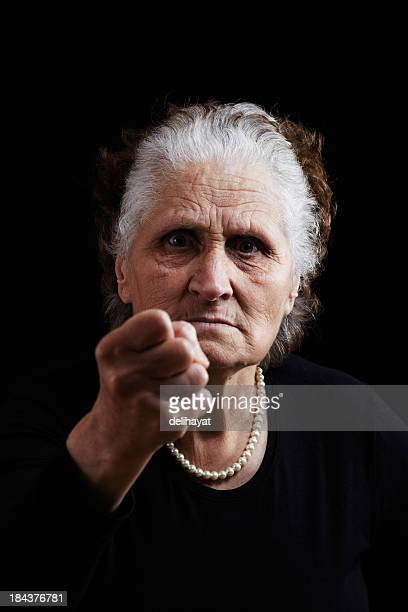 anger - old ugly woman stock photos and pictures