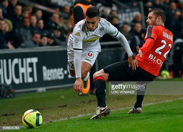 Angers' Algerian defender Said Benrahma fights for the ball with Rennes' French defender Sylvain Armand during the French L1 football match Rennes vs...