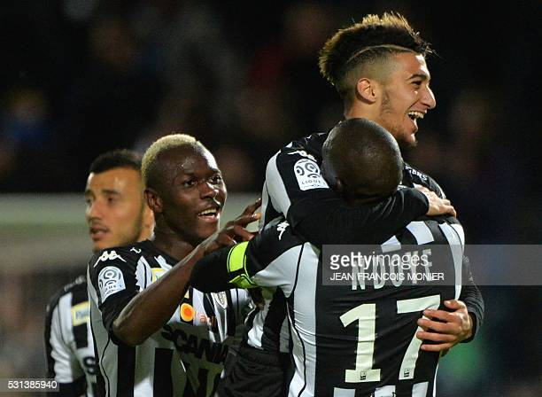 Angers' Algerian defender Said Benrahma is congratulated by his team mates Angers' Guinean forward Mohamed Yattara and Angers' Senegalese midfielder...