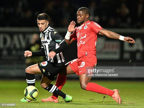 Angers' Algerian defender Said Benrahma vies for the ball with Montpellier's French defender William Remy during the French L1 football match between...