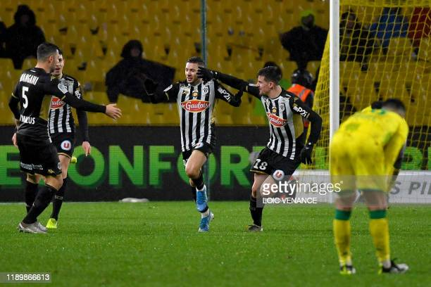 Angers' Algerian forward Farid El Melali celebrates with teammates after scoring a goal during the French L1 football match between FC Nantes and...