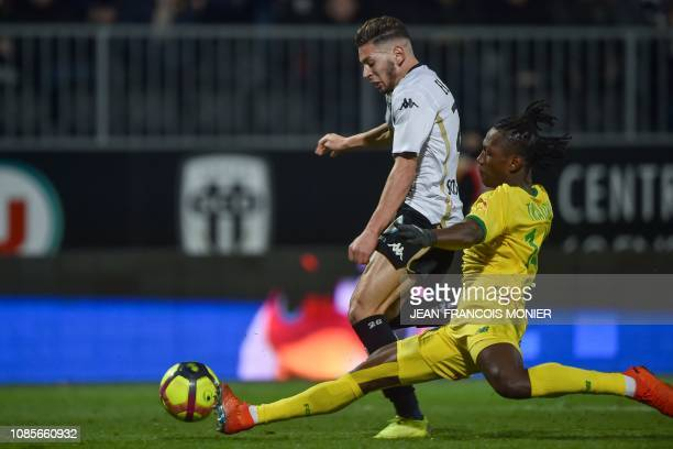 Angers' Algerian forward Farid El Melali fights for the ball with Nantes' Brazilian defender Diego Carlos during the French L1 football match between...
