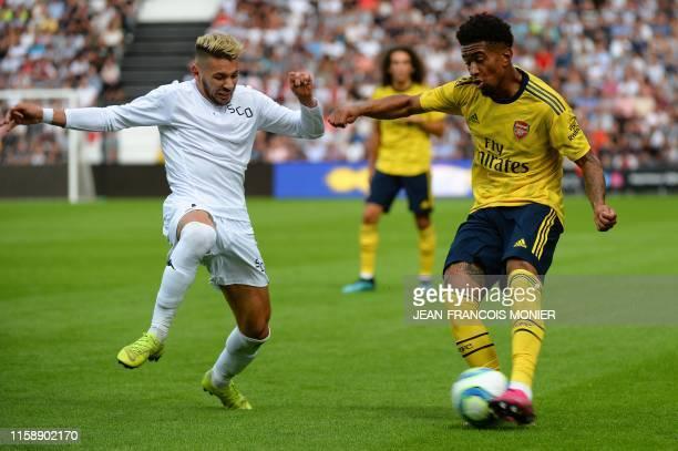 Angers' Algerian forward Farid El Melali vies for the ball with Arsenal's English midfielder Reiss Nelson during the international friendly football...