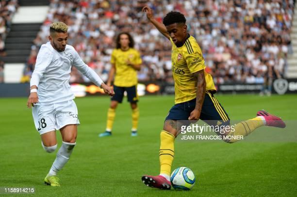 Angers' Algerian forward Farid El Melali vies with Arsenal's English midfielder Reiss Nelson for the ball during the International friendly football...