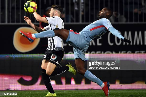 Angers' Algerian forward Farid El Melali vies with Monaco's French defender Fode BalloToure during the French L1 football match between Angers SCO...