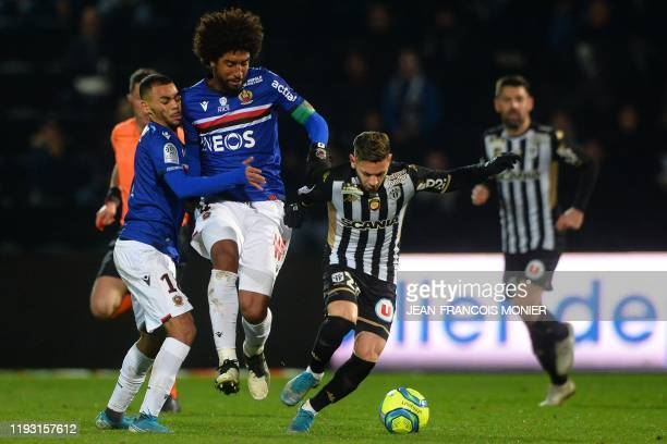 Angers' Algerian forward Farid El Melali vies with Nice's French forward Alexis ClaudeMaurice and Nice's Brazilian defender Dante during the French...