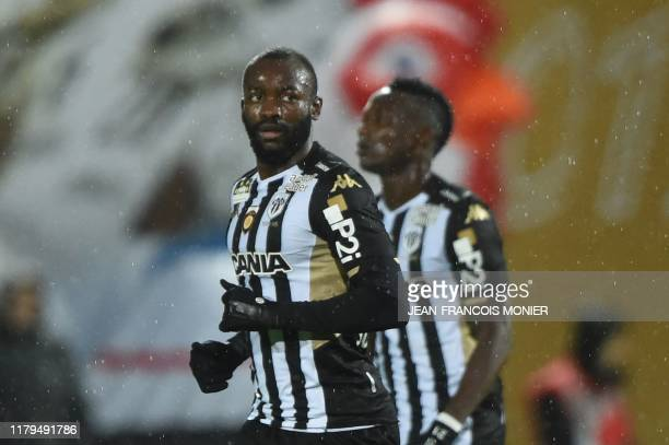 Angers' Cameroon forward Stephane Bahoken reacts after scoring a goal on a penalty during the French L1 football match between Angers SCO and Racing...