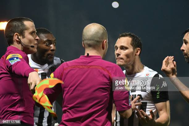 Angers' Cameroonian forward Karl Toko Ekambi and Angers' French defender Vincent Manceau react after French referee Stephane Joachim disallowed a...