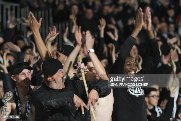 Angers' Cameroonian forward Karl Toko Ekambi claps with Angers' supporters after the French L1 football match between Angers and Nantes on May 12 at...