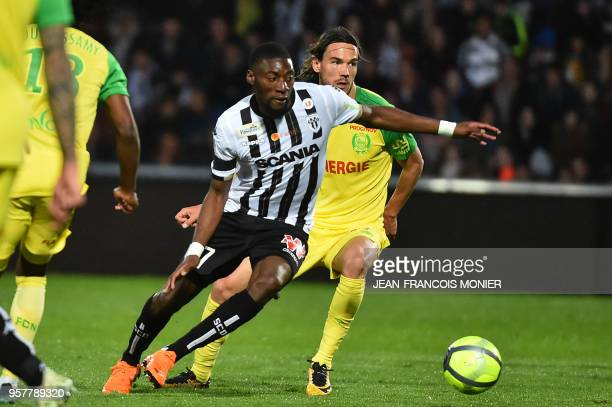 Angers' Cameroonian forward Karl Toko Ekambi vies with Nantes' Slovenian midfielder Rene Krhin during the French L1 football match between Angers and...