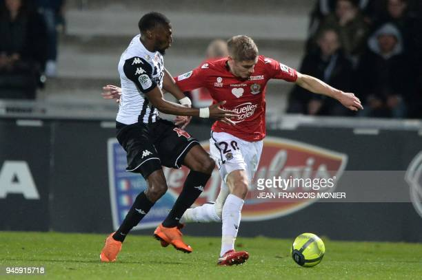 Angers' Cameroonian forward Karl Toko Ekambi vies with Nice's French defender Maxime Le Marchand during the French L1 Football match between Angers...