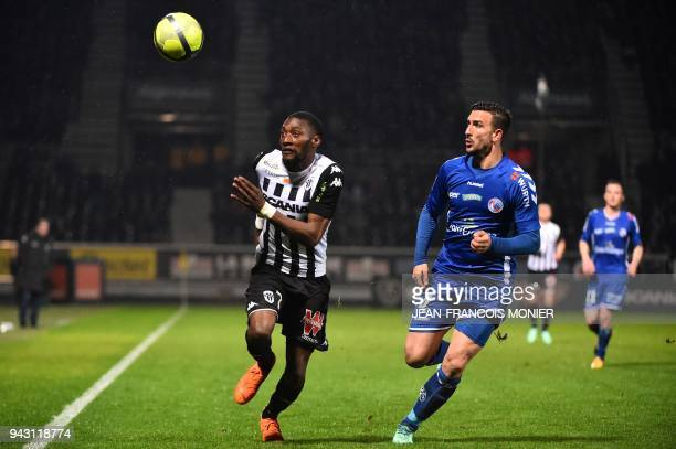 Angers' Cameroonian forward Karl Toko Ekambi vies with Strasbourg's French midfielder Pablo Martinez during the French L1 Football match between...