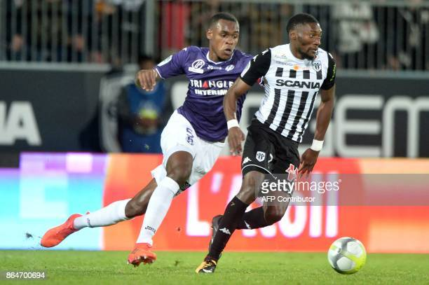 Angers' Cameroonian forward Karl Toko Ekambi vies with Toulouse's French defender Issa Diop during the French L1 football match between Angers and...