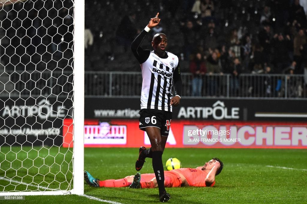 Anger's Congolese midfielder Prince Oniangue jubilates after scoring during the French L1 Football match between Angers (SCO) and Caen (SMC), on March 17, 2018, in Raymond-Kopa Stadium, in Angers, northwestern France. MONIER
