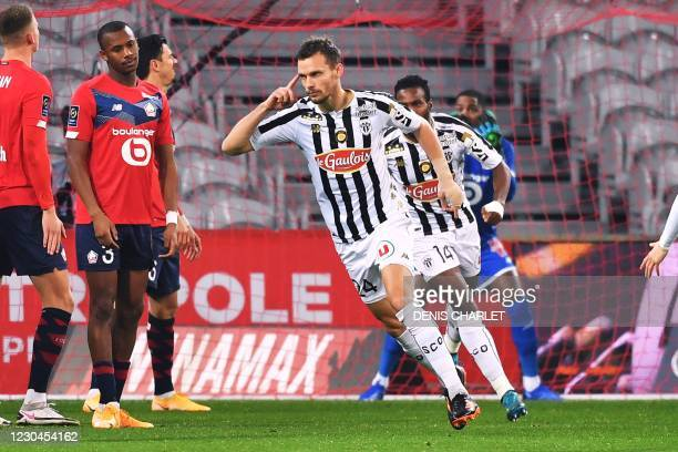 Angers' defender Romain Thomas celebrates after scoring a goal during the French L1 football match between Lille and Angers at the Pierre-Mauroy...