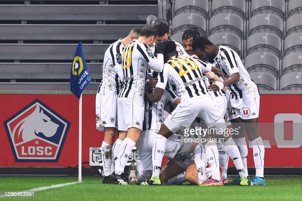 Angers' defender Romain Thomas celebrates with teammates fater scoring a goal during the French L1 football match between Lille and Angers at the...