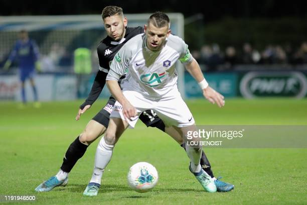 Angers' Farid El Melali vies with Dieppe's Florian Levasseur during the French Cup round of 64 football match between Dieppe and Angers at Des Vertus...