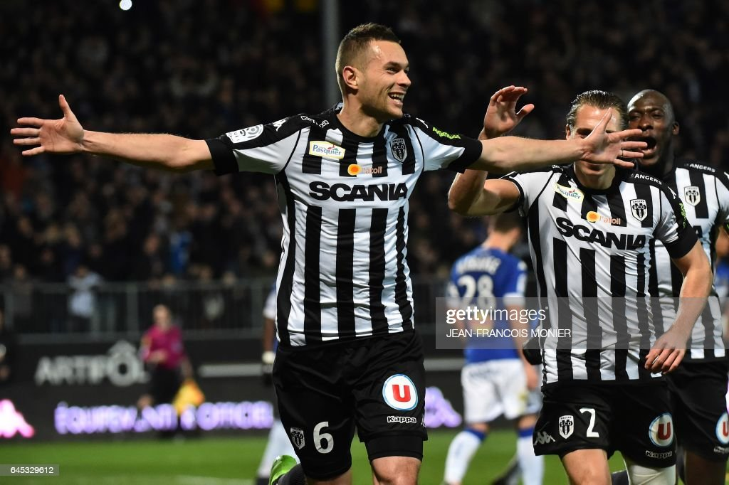 Angers' French defender Gregory Bourillon (L) celebrates after scoring a goal during the French L1 football match between Angers (SCO) and Bastia (SC), on February 25, 2017, at Jean Bouin Stadium, in Angers, northwestern France. / AFP / JEAN