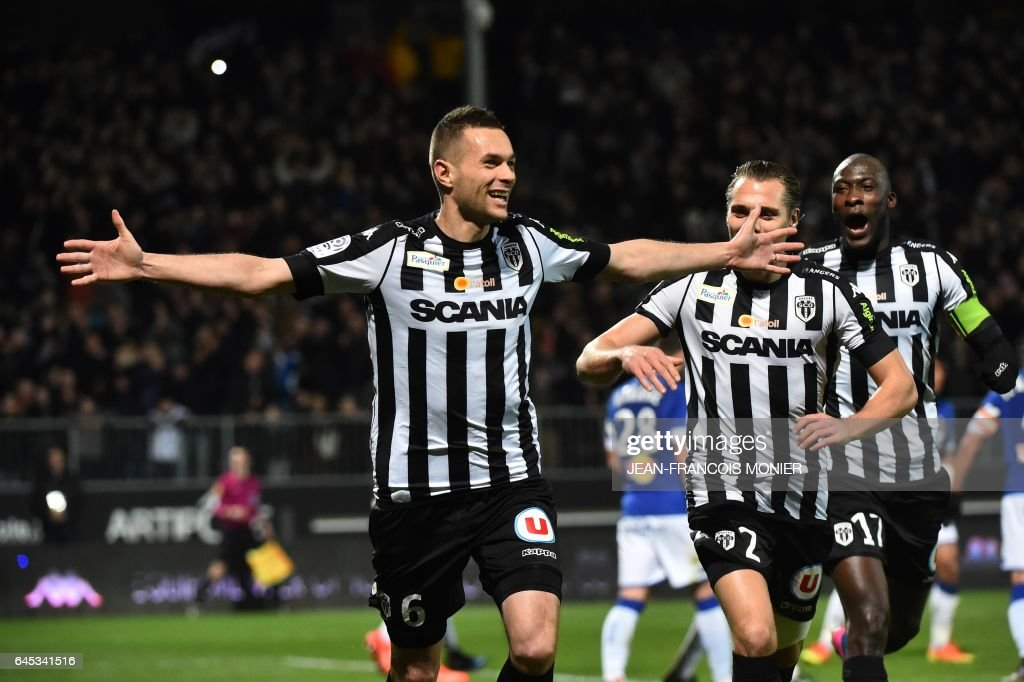 Angers' French defender Gregory Bourillon (C) celebrates after scoring a goal during the French L1 football match between Angers (SCO) and Bastia (SC), on February 25, 2017, at Jean Bouin Stadium, in Angers, northwestern France. / AFP / JEAN