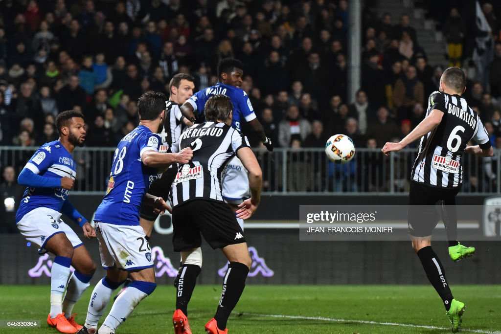 Angers' French defender Gregory Bourillon (R) scores a goal during the French L1 football match between Angers (SCO) and Bastia (SC), on February 25, 2017, at Jean Bouin Stadium, in Angers, northwestern France. / AFP / JEAN