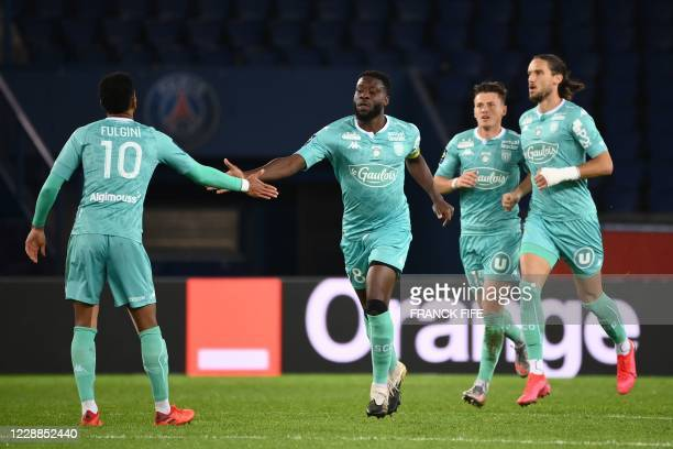 Angers' French defender Ismael Traore celebrates after scoring a goal during the French L1 football match between Paris Saint-Germain and Angers at...