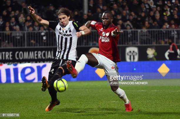 Angers' French defender Mateo Pavlovic vies with Amiens' French forward Moussa Konate during the French L1 football match between Angers and Amiens...