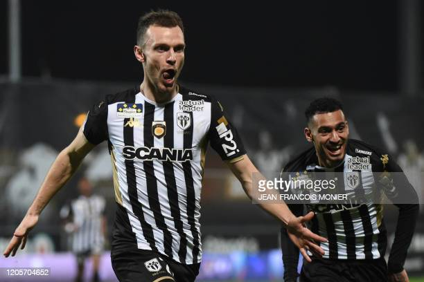 Angers' French defender Romain Thomas celebrates after scoring his team's second goal during the French L1 Football match between Angers SCO and FC...