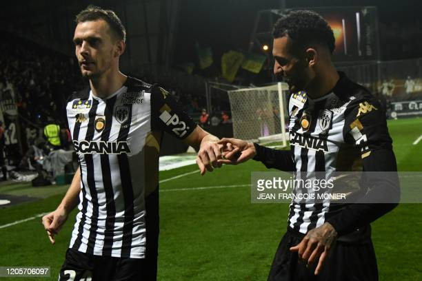 Angers' French defender Romain Thomas celebrates with Angers' French midfielder Angelo Fulgini after scoring his team's second goal during the French...