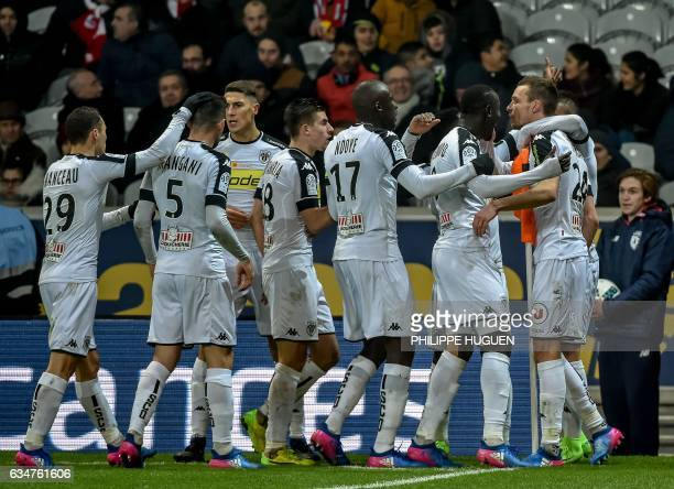 Angers' French defender Romain Thomas celebrates with his teammates after scoring a goal during the French L1 football match between Lille and Anger...