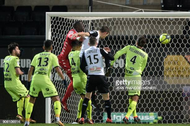 Angers' French defender Romain Thomas scores a goal during the French L1 football match between Angers and Troyes at the RaymondKopa Stadium in...
