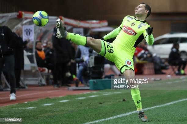 """Angers' French defender Vincent Manceau controls the ball during the French L1 football match Monaco vs Angers on February 4 at the """"Louis II..."""