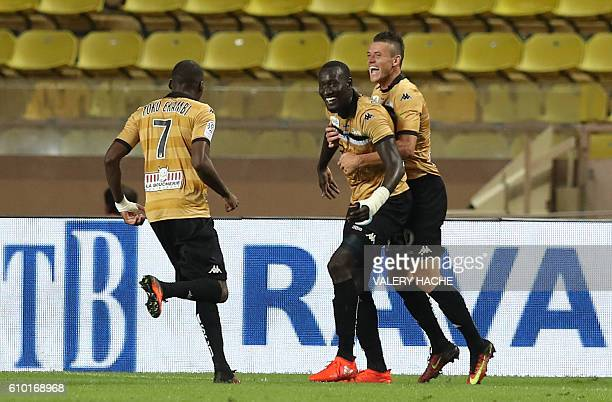 Angers' French forward Famara Diedhiou is congratulated by teammates after scoring a goal during the French L1 football match Monaco vs Angers on...
