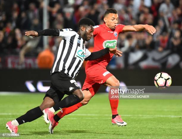 Angers' French forward Jonathan Mamba vies with Guingamp's Brazil defender Fernando Marcal during the French Cup semifinal match between Angers and...