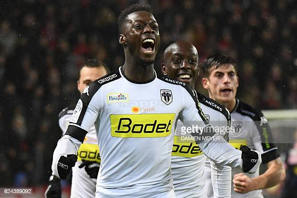 Angers' French forward Nicolas Pepe celebrates after scoring a goal during the French L1 football match between Rennes and Angers at the Roazhon park...