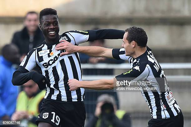 Angers' French forward Nicolas Pepe celebrates with Angers' French defender Vincent Manceau after scoring a goal during the French L1 football match...