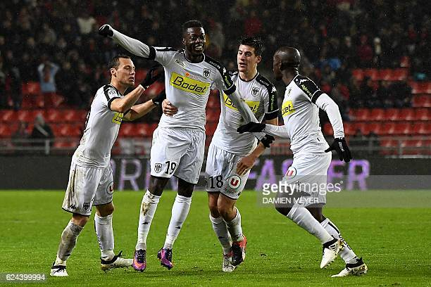 Angers' French forward Nicolas Pepe celebrates with teammates after scoring a goal during the French L1 football match between Rennes and Angers at...