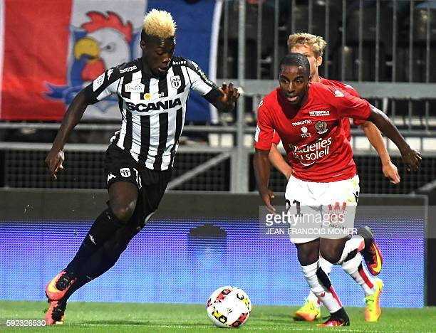 Angers' French forward Nicolas Pepe vies for the ball with Nice's Portuguese defender Ricardo Pereira during the French L1 football match between...