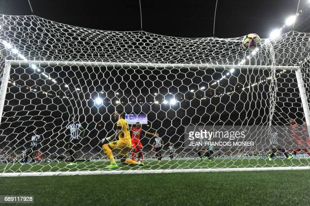 Angers' French goalkeeper Alexandre Letellier and Paris SaintGermain's Brazilian defender Thiago Silva react after Angers scored an own goal during...