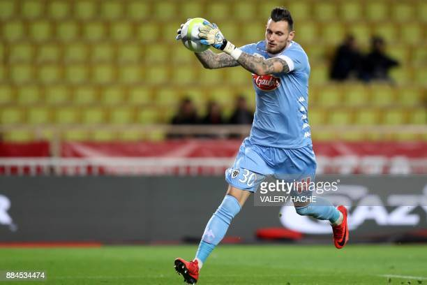 Angers' French goalkeeper Alexandre Letellier grabs the ball during the French L1 football match Monaco vs Angers on December 2 2017 at the Louis II...