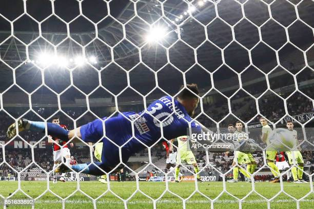 Angers' French goalkeeper Alexandre Letellier stops the ball during the French L1 football match between Nice and Angers at Allianz Riviera Stadium...