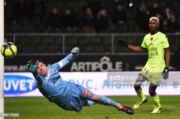 Angers' French goalkeeper Ludovic Butelle jumps for the ball during the French L1 football match between Angers and Troyes at the RaymondKopa Stadium...