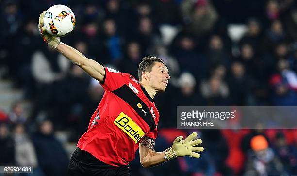 Angers' French goalkeeper Mathieu Michel passes the ball during the French L1 football match between Paris SaintGermain and Angers at the Parc des...