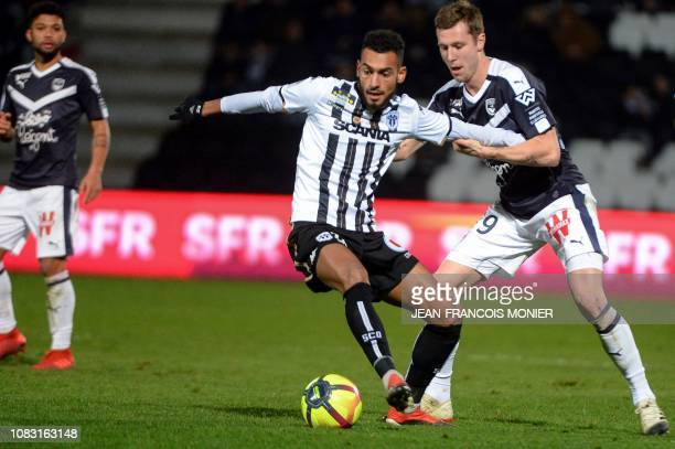 Angers' French midfielder Angelo Fulgini fights for the ball with Bordeaux's Danish forward Andreas Cornelius during the French L1 football match...