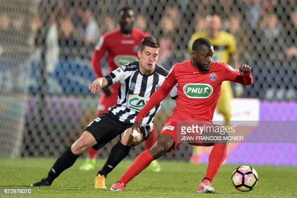 Angers' French midfielder Baptiste Santamaria vies for the ball with Guingamp's French midfielder Yannis Salibur during the French Cup semifinal...