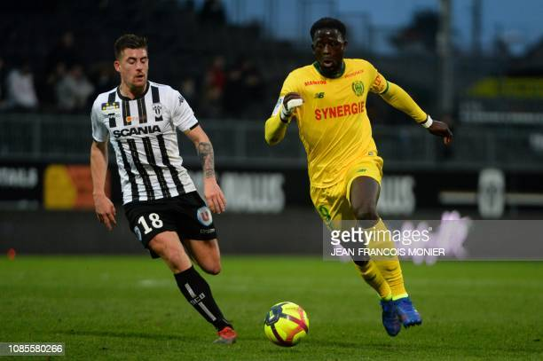 Angers' French midfielder Baptiste Santamaria vies with Nantes' French midfielder Abdoulaye Toure during the French L1 football match between Angers...
