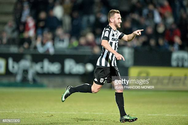 Angers' French midfielder Flavien Tait celebrates after scoring a goal during the French L1 football match between Angers and Metz on January 28 in...