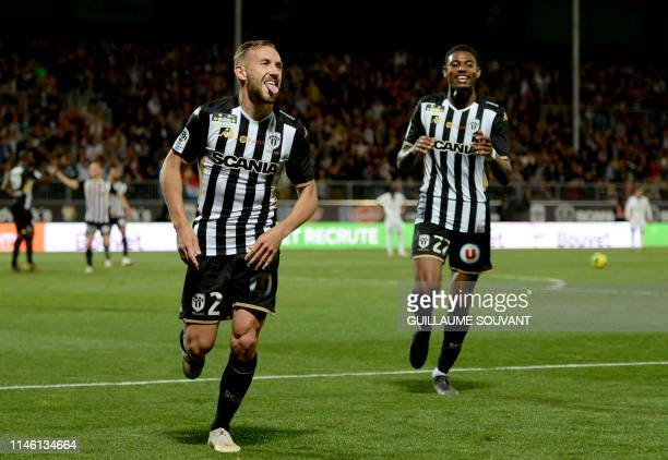 Angers' French midfielder Flavien Tait celebrates with Angers' French midfielder Jeff Reine Adelaide after scoring a goal during the French L1...